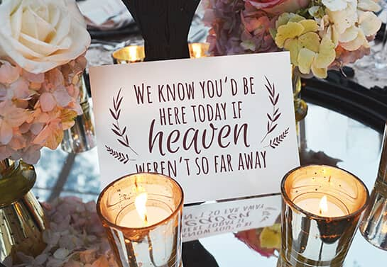 memorial table wedding sign idea with a quote surrounded with candles