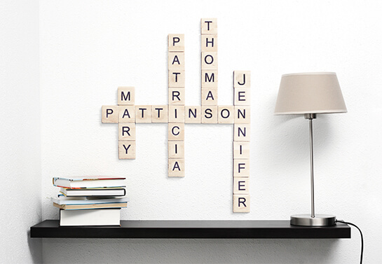 Mother's day wooden wall art project with family names' scrabble