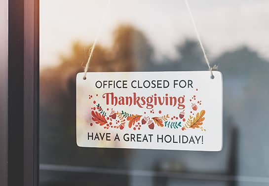 office closed for Thanksgiving sign in white with colorful holiday icons