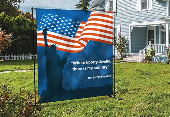 4th of July booth idea in blue displaying Benjamin Franklin quote