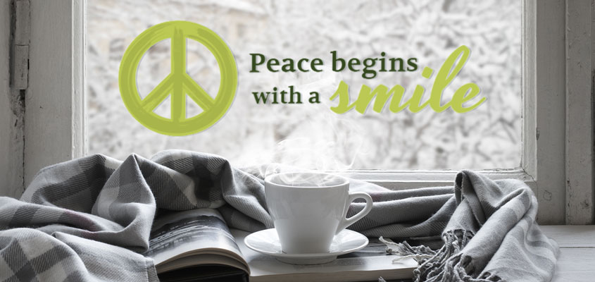 home window decorative decal with a peace symbol and quote