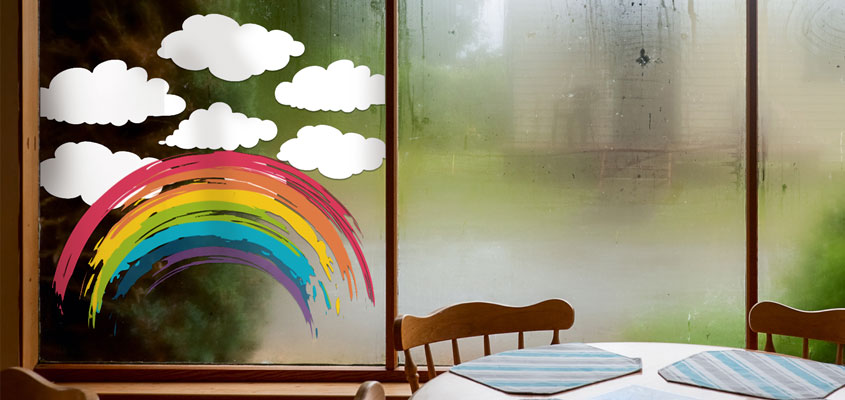 kid's room window decorating idea with cute rainbow and cloud decals