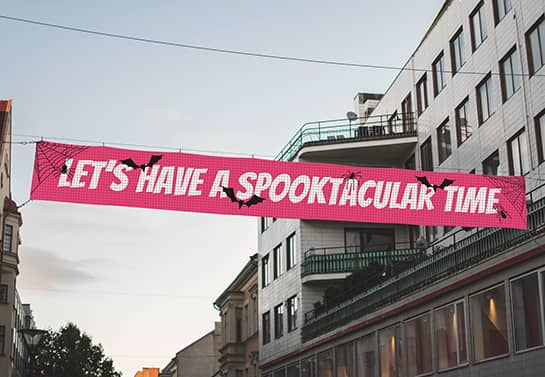 pink Halloween party banner in a big size hung in the street