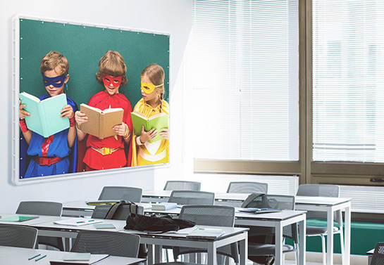 cute school banner displaying little superheroes reading a book