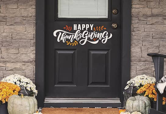 Happy Thanksgiving sign in white fixed to the front door
