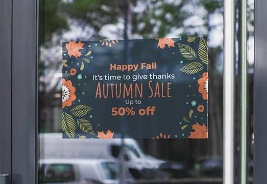 store sale sign with Thanksgiving-themed patters