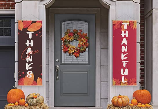 two colorful Thanksgiving welcoming banners at the front door