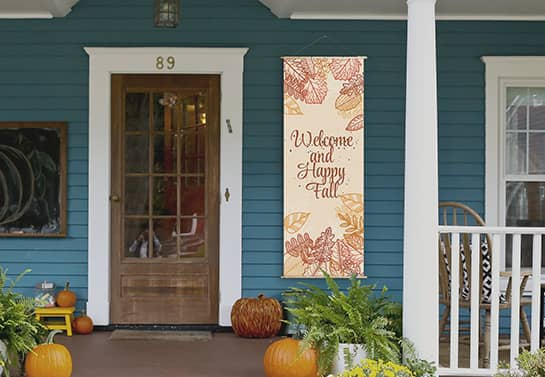 welcoming Thanksgiving porch sign hanging at the door