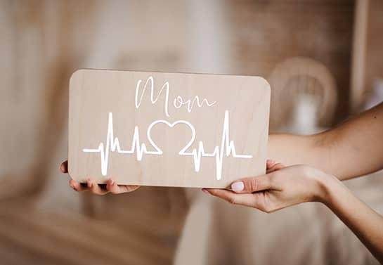 Unique mother's day sign idea with a heartbeat sonogram line print and the word Mom
