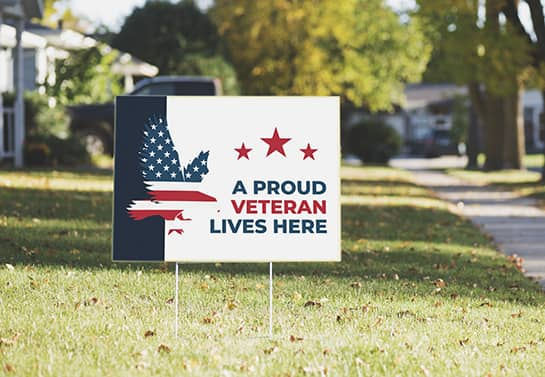 Veterans Day yard sign with a Veteran Lives Here display