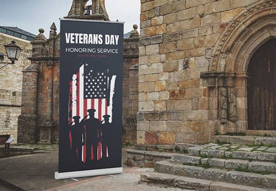 Veterans Day church event sign in a dark color displayed at the entrance