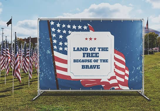 large outdoor Veterans Day backdrop displaying a patriotic quote