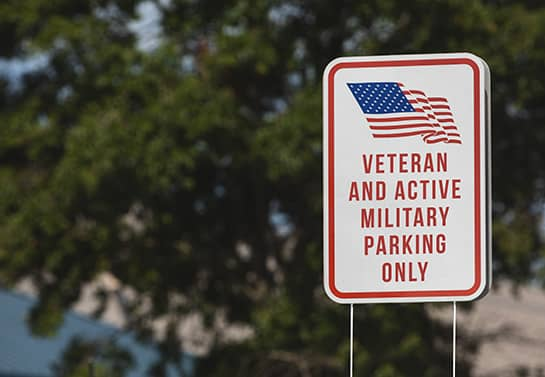 Veterans Day parking sign in white