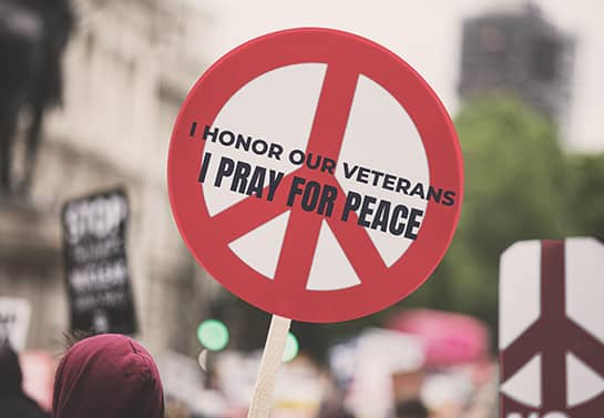Veterans Day peace sign in a round shape in red color
