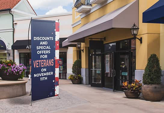 Veterans Day sale banner in blue displayed outdoors