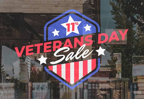 Veterans Day sale sign displaying a 11% discount on the window