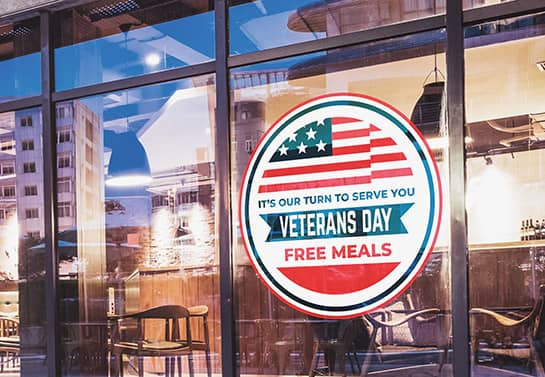 Veterans Day free meals sign in a round shape