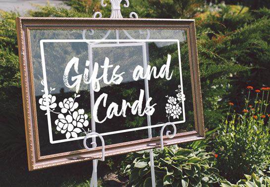 beautiful transparent wedding guest sign board idea for outdoor space