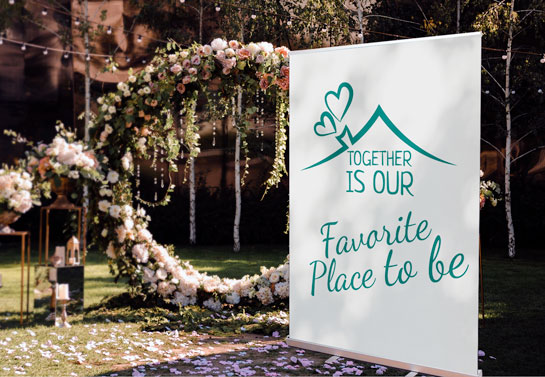 love quote on outdoor wedding backdrop banner