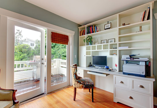 space saving white cabinets in the home office