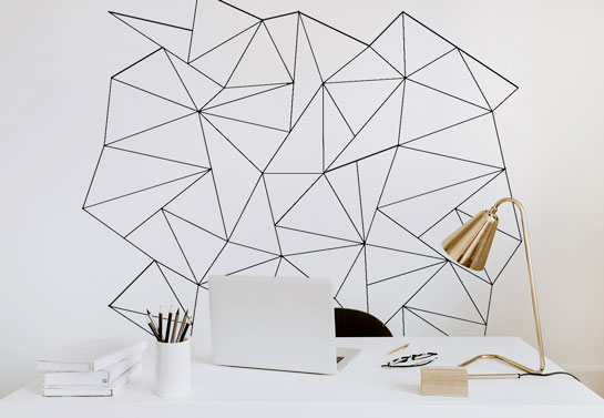white home office with simple black wall decor