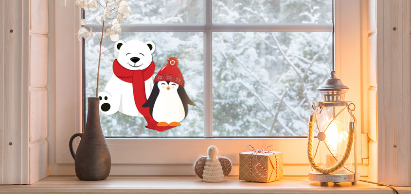 winter themed home window decorating idea with cute bear and penguin decals