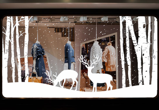 christmas window decoration idea with winter forest decals