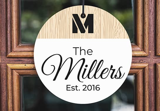 wood sign idea with the surname The Millers hung on the door