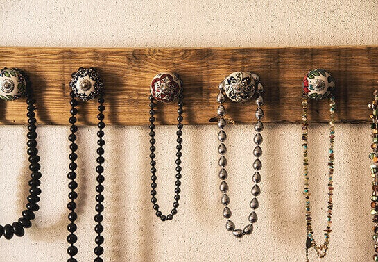 Jewelry holder with a wooden board