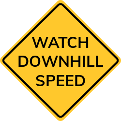 Watch downhill speed | yellow signs warn to slow down the speed