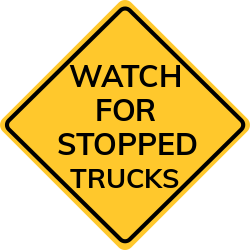 Watch for stopped trucks sign | Provides extra safety on roads
