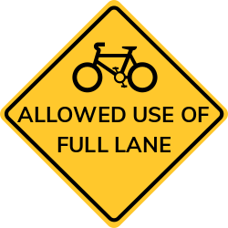 May use full lane sign | It encourages bicyclists to use the full lane
