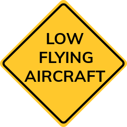 Sign warns drivers not to panic in case of low flying planes