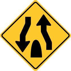 Divided highway ends sign | Prepare to change lanes.