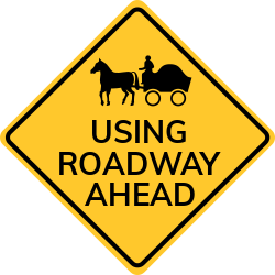 Horse Drawn vehicle ahead sign | Warns to go slowly,due to bad road