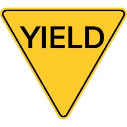 Yield sign with triangle shape on a yellow background