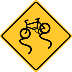 Bike lane slippery when wet sign | Supposes you to reduce the speed