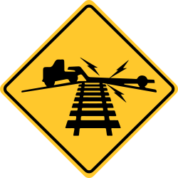 Railroad crossing | Sign informs drivers about uneven road surface at