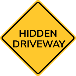 Hidden driveway sign | Points out the road part that are yet to get